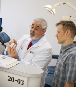 Dr. Gary Heir, left, explains his treatment plan to patient Jerry Williamson.