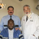 From left, patient Samuel Nyamwange, Dr. Louis DiPede and Dr. Gary Heir.